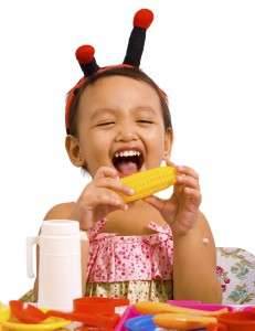 Little-girl-playing-with-toy-food-231x300