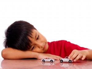 young-boy-playing-with-cars-300x226