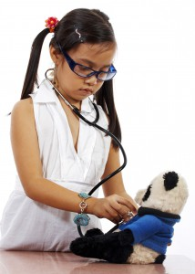 young-child-playing-doctor-with-her-teddy-bear-214x300