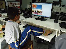 Boy with disability using computer