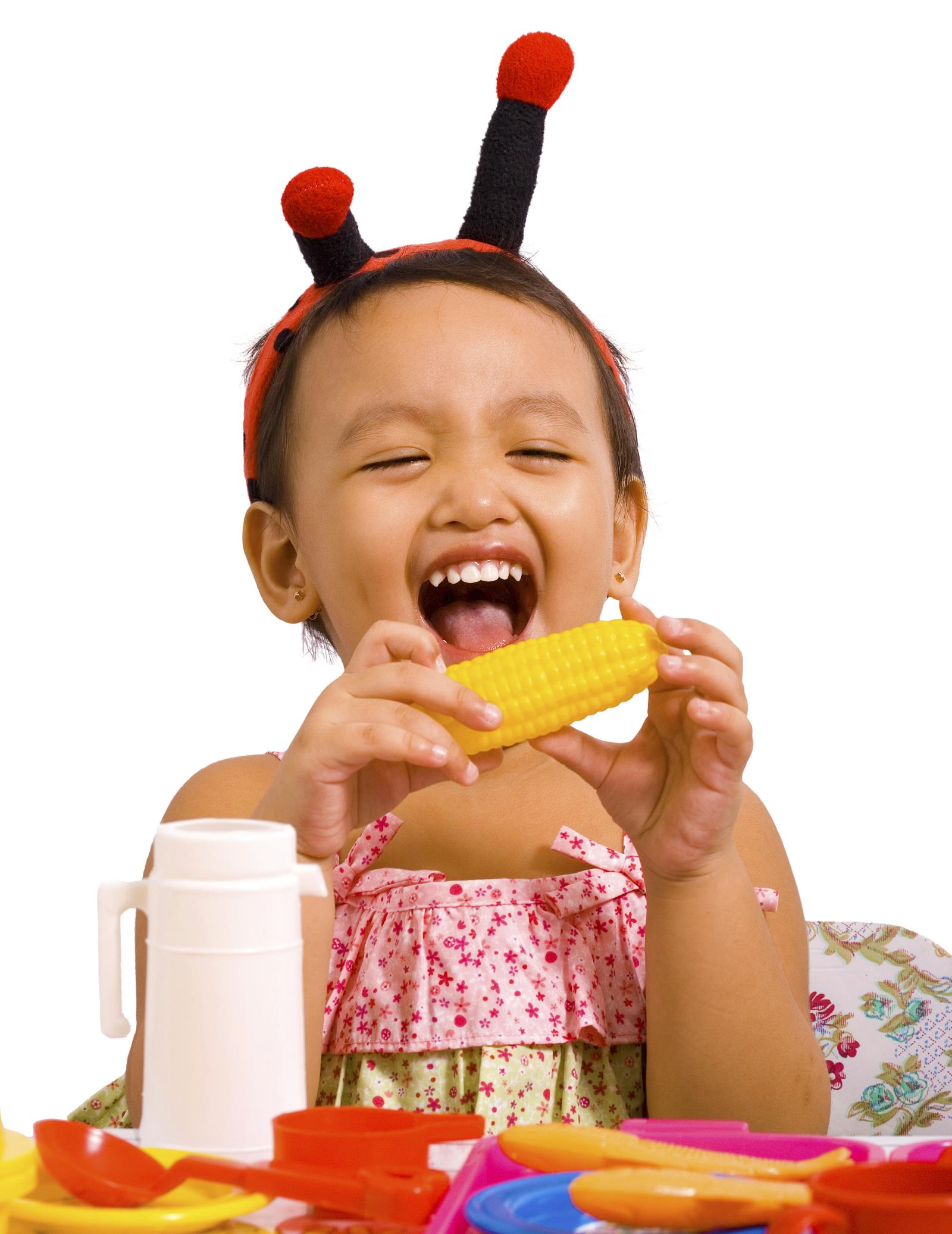 Little girl playing with toy food