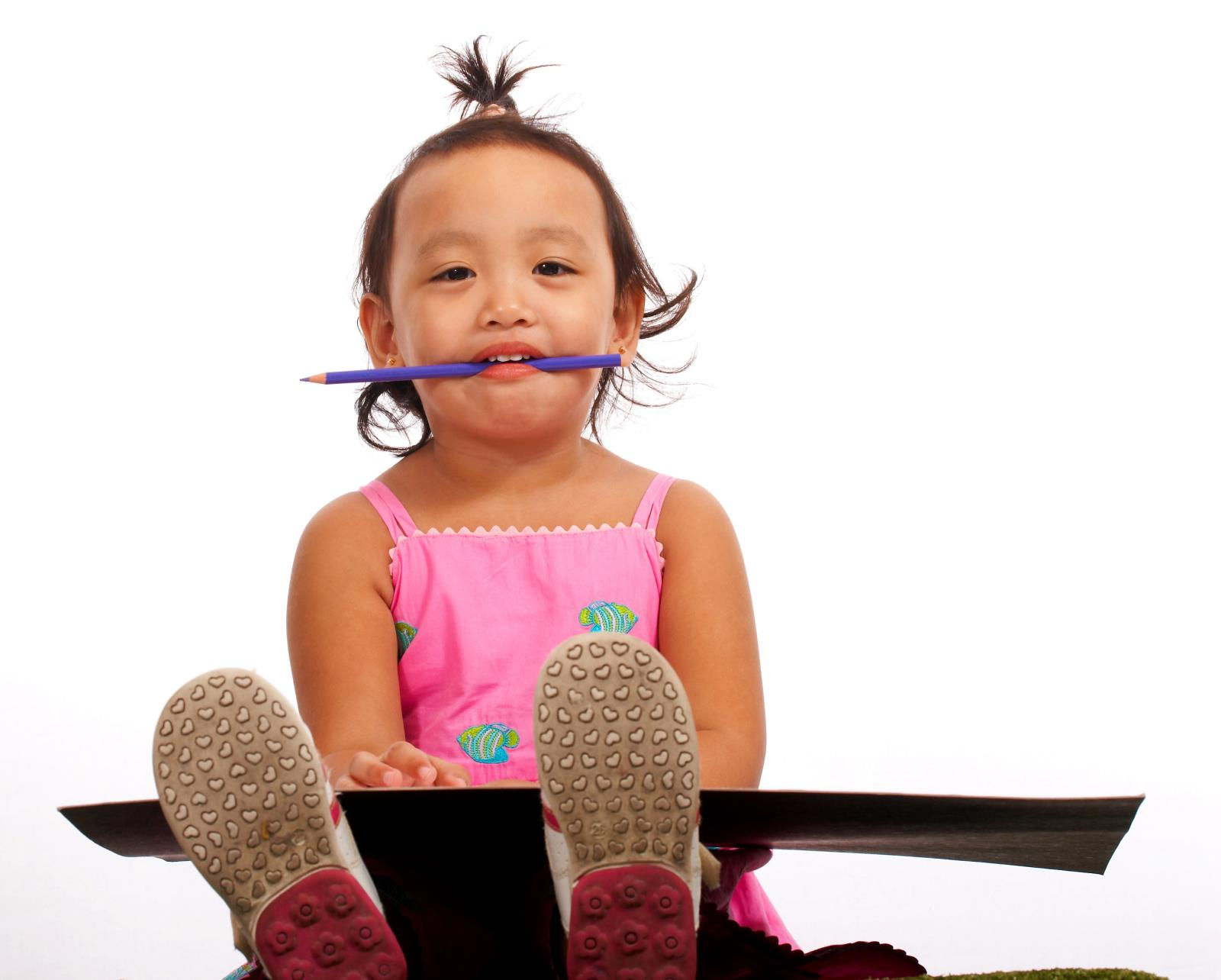 little girl with pencil in mouth graphicstock