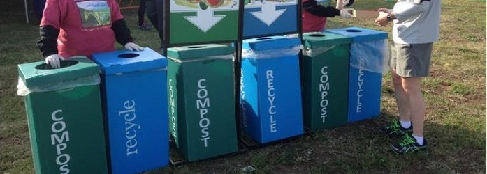 recyling bins lined up at an event