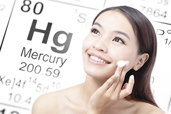 Woman putting on skin cream with mercury element on background-web