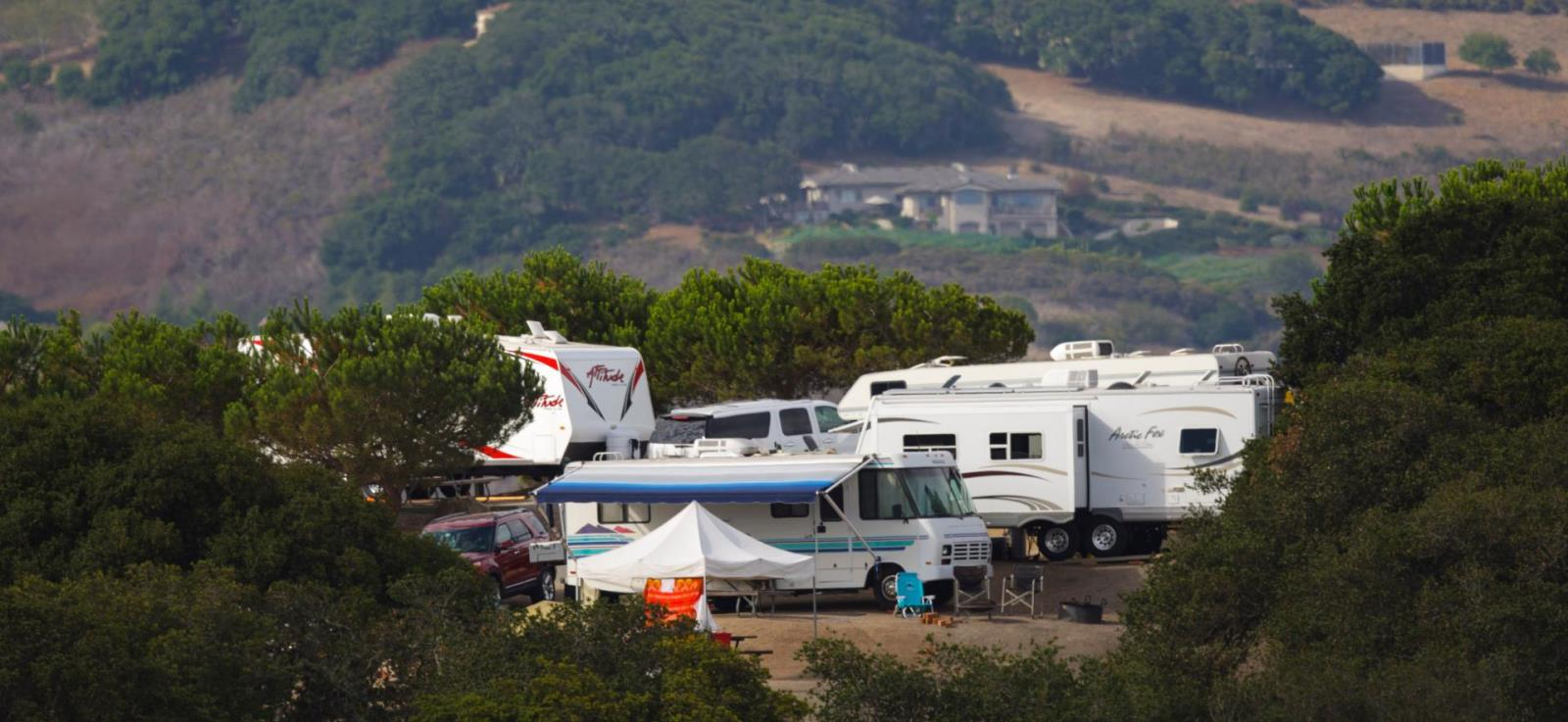 image of multiple rv's in camping area