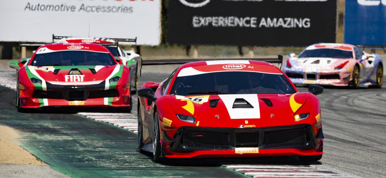 photo of ferraris racing on track