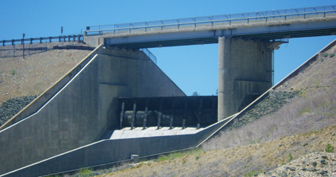 photo of raised rubber dam as seen from front of spillway